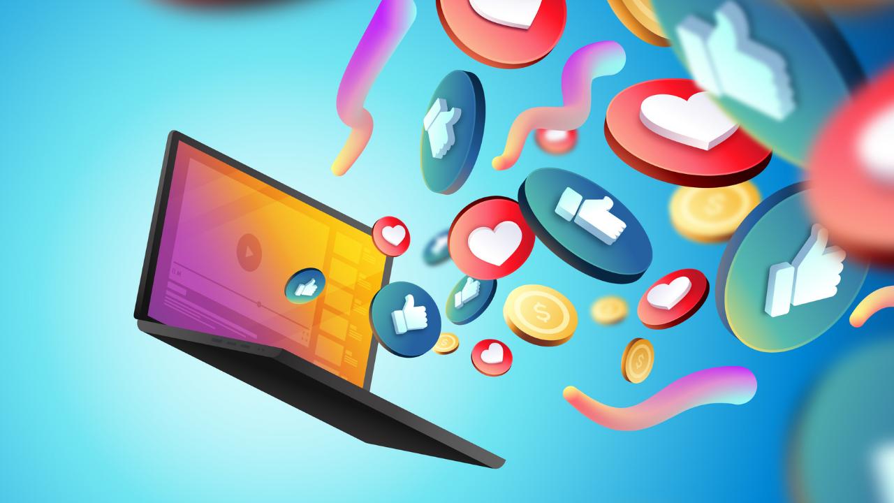 Imagem notebook com as logos das redes sociais saindo da tela